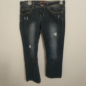 Distressed red rivet jeans
